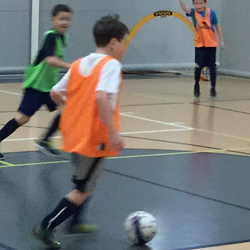 Image of Boys in Gym traing with futsal ball - premiere indoor training - World Class Soccer School